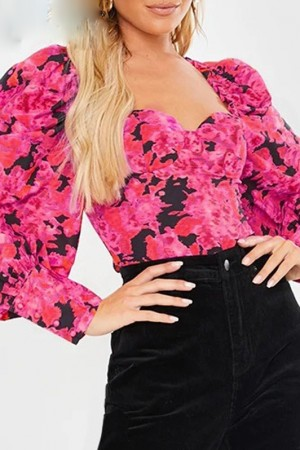 Beyoncé Rose Ruffle Top